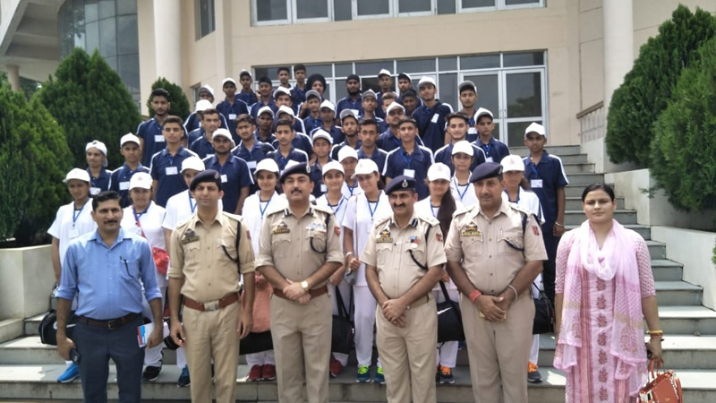 IGP Jammu Zone Dr SD Singh Jamwal, police officers and students posing for group photograph.