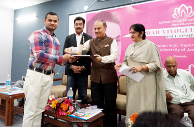 JU VC presenting Kunwar Viyogi Memorial scholarship during a programme on Monday.