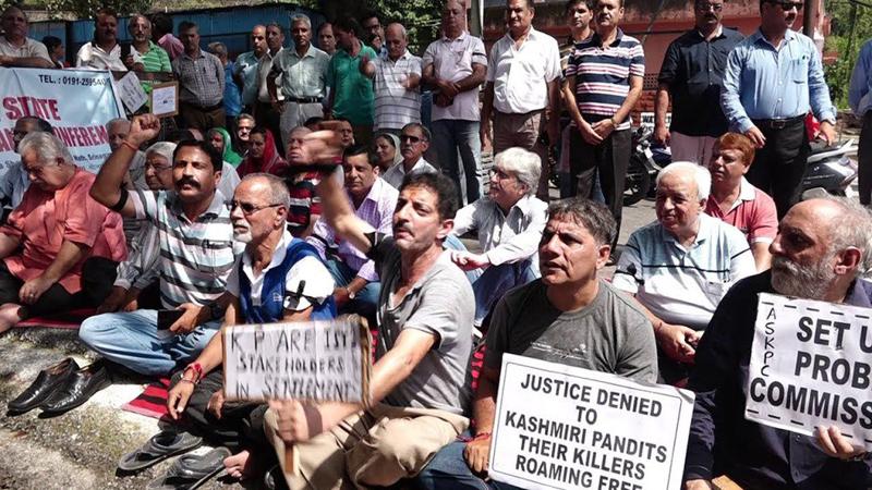 Kashmiri Pandits sitting on protest dharna outside Raj Bhawan in Jammu on Friday.