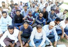 Casual labourers and need based workers of PWD (R&B) Department staging a protest at Rajouri.