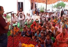 BJP leader and MLC Ch Vikram Randhawa addressing a meeting at Jinder Melu in R S Pura on Tuesday.