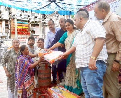 MLA Priya Sethi distributing free cooking gas connections at Jammu on Wednesday.