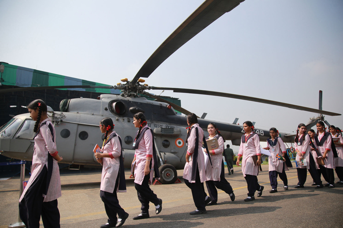 School girls watching an IAF helicopter during a function organised at Jammu on Friday. -Excelsior/Rakesh