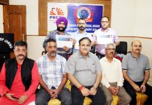 PCJ president, Ashwani Kumar and other executive committee members posing with first three winners of Ashok Sodhi Memorial Awards.