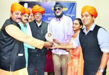 MLA Udhampur, Balwant Singh Mankotia, along with other dignitaries presenting a memento to international Skater, Chandeep Singh, at Jammu.