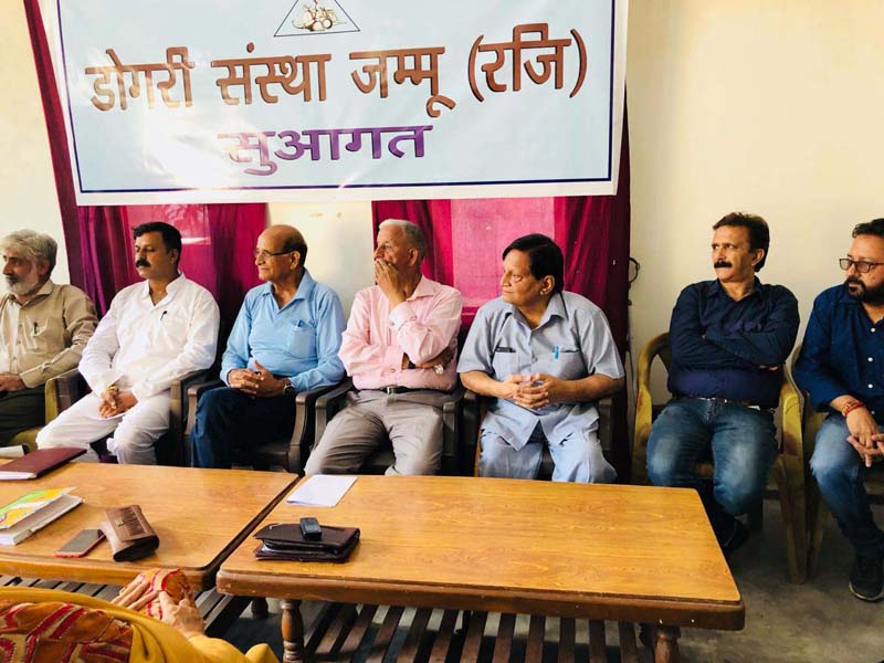 Dogri writers during a short story reading session at Jammu on Saturday.