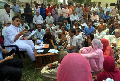 MLA RS Pathania listening to public grievances during Janta Darbar at Ramnagar on Wednesday.