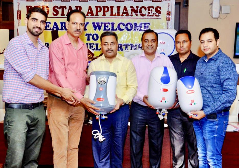 Neeraj Anand, President, Chamber of Traders Federation Jammu and officials of Red Star Company launching full range of geysers in Jammu.