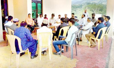 BJP leader Wasim Kohli interacting with party workers in Kalakote.