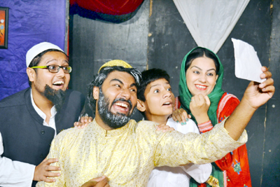 A scene from the play 'Lottery Ka Ticket' staged by Natrang at Jammu on Sunday.