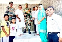 Former Minister and MLA Chander Prakash Ganga paying homage to Shaheed Ravi Paul at Sarwa, Ramgarh in Samba.