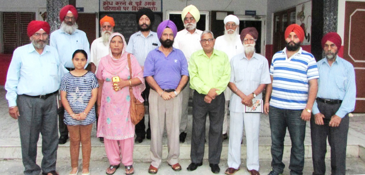 Literary persons of Punjabi language posing for a group photograph after a literary meet at Jammu on Sunday.