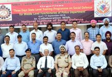 Participants of training programme on social defence issues posing for group photograph.