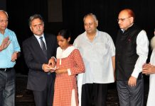 Advisor Khurshid Ahmad Ganai presenting award to a student during a function in Jammu on Tuesday.