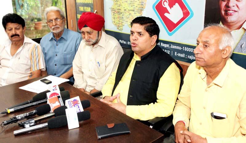 SOS Intl leader Rajiv Chuni talking to media-persons in Jammu. -Excelsior/ Rakesh