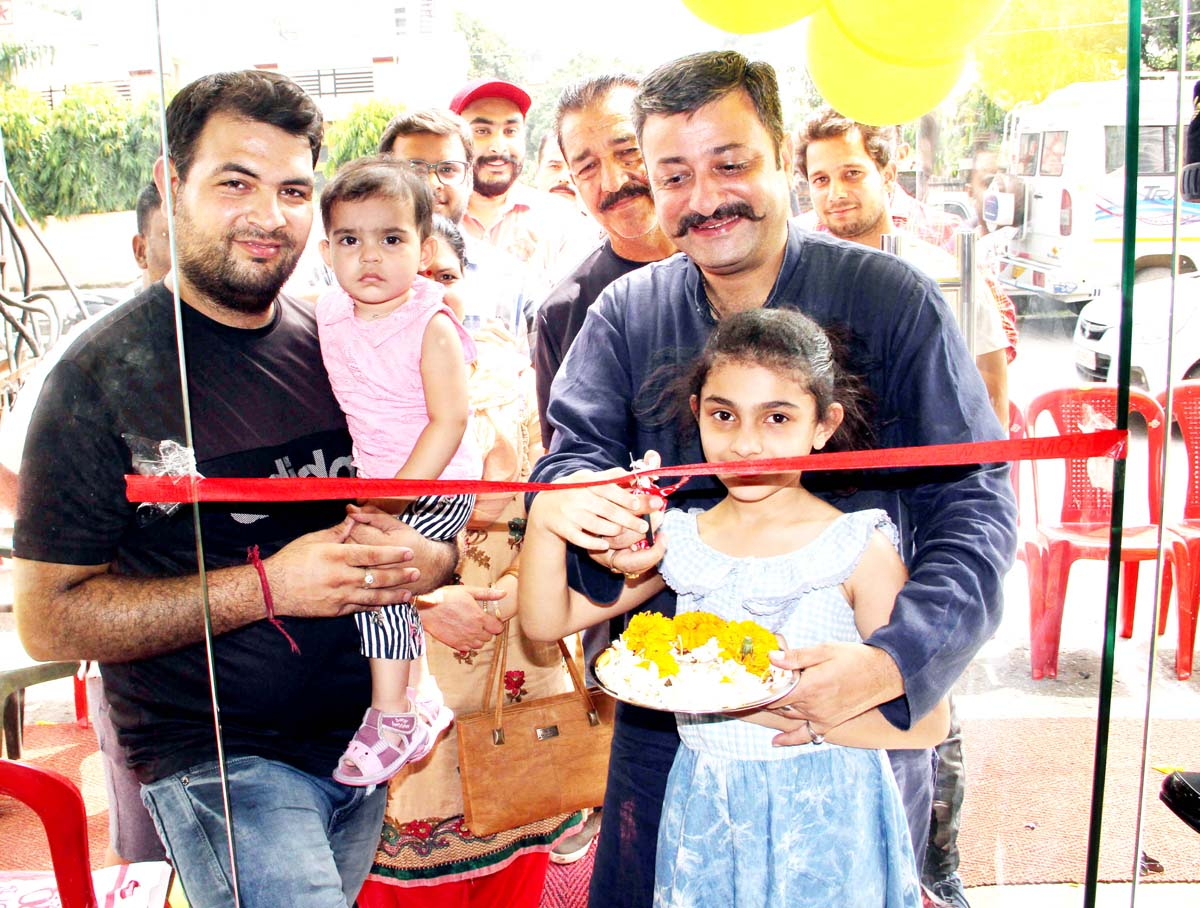 Team Jammu chairman inaugurating garments outlet on Tuesday.