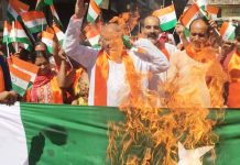 Dogra Front and Shiv Sena activists torching Pak flag during a protest in Jammu on Wednesday.