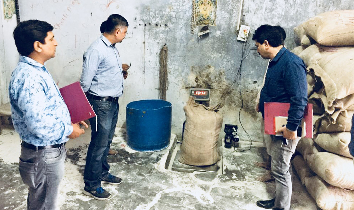 Director FCS&CA Jammu, Amit Sharma, checking weight of an Atta bag during inspection of a Flour Mill.