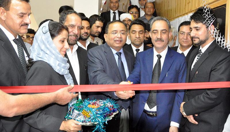 Justice Ali Mohammad Magrey, Member NLSA inaugurating a National Lok Adalat at Srinagar on Saturday.