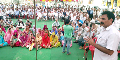 DCC Kathua president, Dr Manohar Lal Sharma addressing public meeting at Billawar on Tuesday.