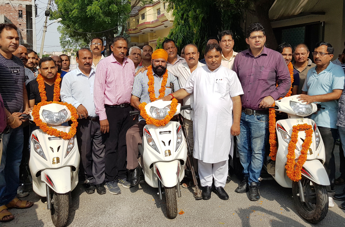 Former Minister & MLA Jammu West, Sat Sharma distributing two wheelers to differently abled persons at Jammu on Thursday.