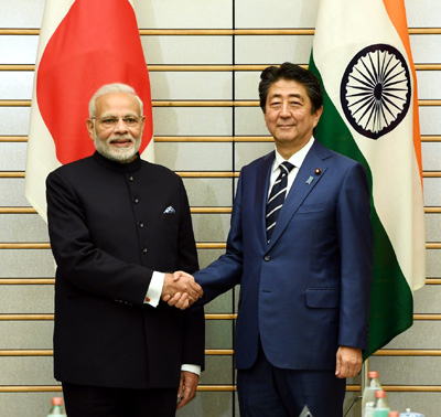 Prime Minister, Narendra Modi being received by the Prime Minister of Japan, Shinzo Abe, during the welcome ceremony, in Tokyo, Japan on Monday.