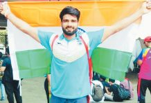 Sandeep Chaudhary holding Indian Flag after climbing World Record.