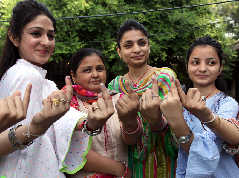 Enthusiastic women voters posing after casting their votes in Science College area of Jammu. -Excelsior/Rakesh