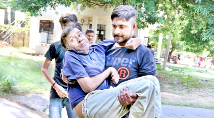A physically challenged person being taken to polling station in Old University Campus on Monday. -Excelsior/Rakesh