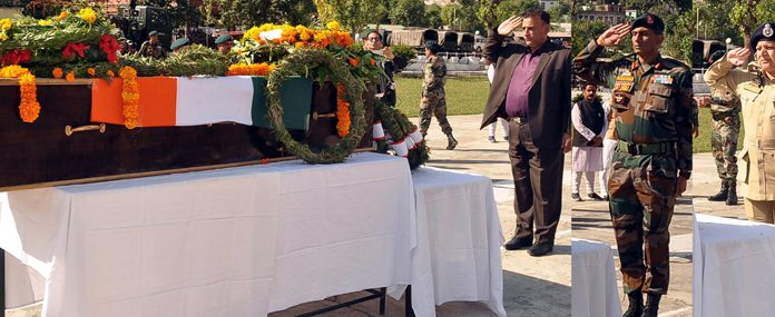 Tributes being paid to martyr Lance Naik Ranjeet Singh in district Ramban on Monday. -Excelsior/Pervaiz