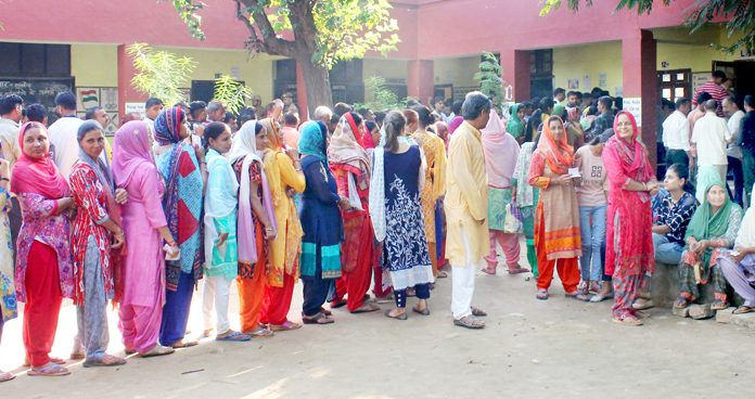 A long queue at a polling booth in Muthi on Monday. -Excelsior/Rakesh