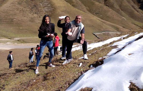 Tourists enjoy fresh snowfall at Padri, Bhaderwah. -Excelsior/Tilak Raj