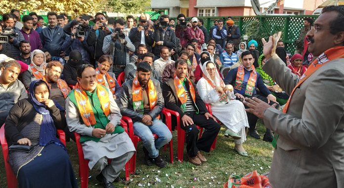 BJP general secretary Ram Madhav addressing party workers and winning candidates at Church lane in Srinagar on Wednesday. —Excelsior/Shakeel