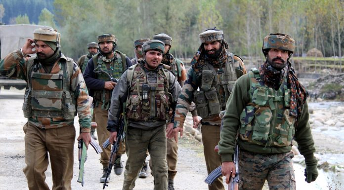 Troops on way to site of encounter at Handwara in Kupwara district on Thursday. -Excelsior/Aabid Nabi