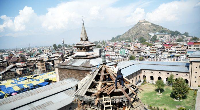 Carpenters renovated wooden minarets of historic Jamia Masjid in Srinagar. -Excelsior/Shakeel
