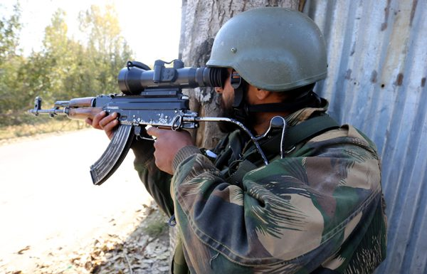 An Army soldier takes position during encounter at Kreeri, Baramulla on Thursday. -Excelsior/Aabid Nabi