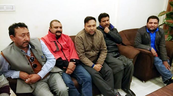 NC and Cong leaders at a meeting in Kargil on Sunday. —Excelsior/Basharat Ladakhi
