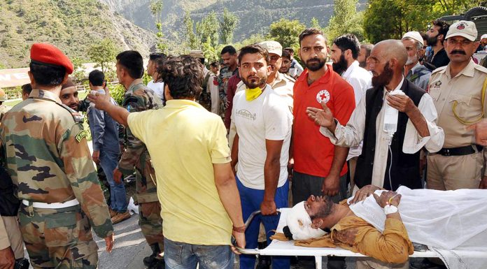 Volunteers shifting an injured person to District Hospital Ramban. —Excelsior/Parvaiz