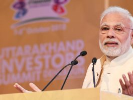 Prime Minister Narendra Modi addressing the 1st Uttarakhand Investors Summit in Dehradun, Uttarakhand on Sunday. (UNI)