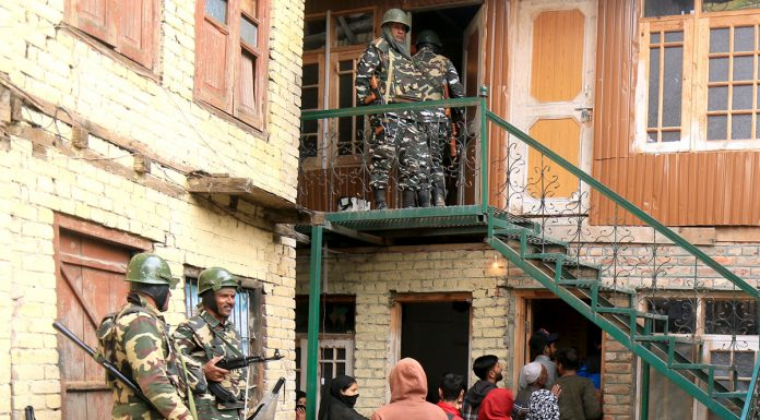 Voters enter polling station to cast votes in Srinagar on Tuesday. -Excelsior/Shakeel