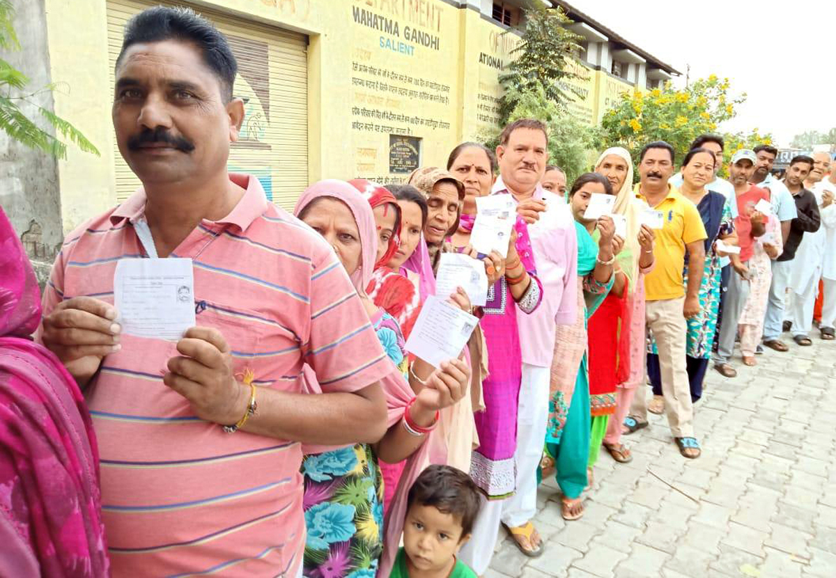 People waiting in a long queue to cast their votes before a polling booth in Kathua on Wednesday.