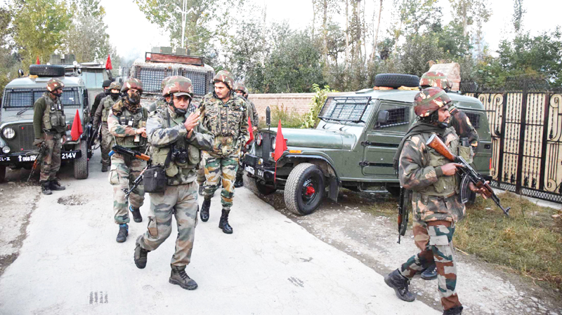 Troops at the site of encounter at Babagund in Pulwama district on Saturday. —Excelsior/Younis Khaliq