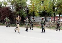 Troops cordon off the area at Kralhaar in Baramulla after killing of two militants on Friday. -Excelsior/Aabid Nabi