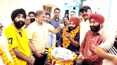 Former Deputy CM and MLA Gandhi Nagar, Kavinder Gupta handing over a scooty to a differently abled person on Monday.