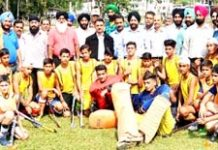 Young players posing for a group photograph along with chief guest and other dignitaries during opening ceremony of inter-district Hockey tournament.