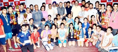 Young paddlers posing along with chief guest Devinder Singh Rana and other dignitaries during valedictory function in Jammu on Thursday.