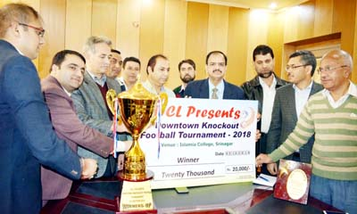 Principal Chief Conservator of Forests (PCCF) Suresh Chugh honouring JK Forest Football team in Srinagar.
