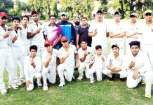 Winners posing along with officials at Col Chopra Cricket Academy in Jammu.