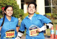 Young female athletes sweating-it-out during Rajouri Marathon on Sunday.