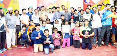 Winners of State Level Table Tennis Championship and dignitaries posing for photograph at Indoor Sports Complex MA Stadium Jammu on Tuesday.